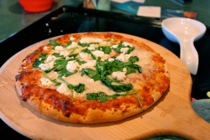 Costco Pizza (shh... ) with arugula and goat cheese